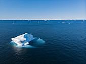Polar ice melting on blue Atlantic Ocean Greenland