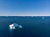 Polar ice melting on vast blue Atlantic Ocean Greenland