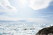 Glacial ice melting below sky Greenland