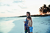 Happy family relaxing on tropical ocean beach Mexico