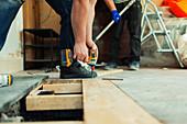 Construction worker installing floorboards