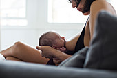 Mother breastfeeding newborn baby son