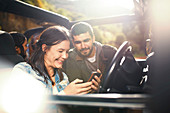 Young couple checking GPS on smart phone