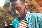 Young man texting with cell phone