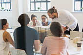 Architects examining model in conference room meeting