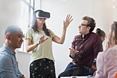 Computer programmers testing virtual reality simulator