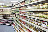 Jars of food lining shelves in supermarket