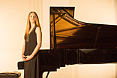 Pianist standing at piano