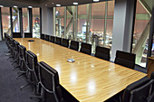 Empty conference room overlooking London at night