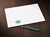 Coloring pencil by puzzle and green puzzle piece