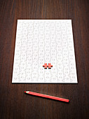 Coloring pencil by puzzle and red puzzle piece