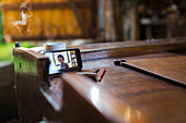 Colleagues video chatting on smart phone on wooden boat