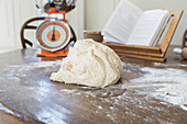 Dough on floured surface in kitchen