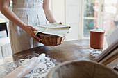 Teenage girl proofing dough in basket