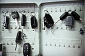 Keys on hooks in auto repair shop