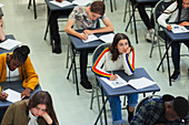 Thoughtful girl taking exam