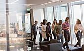 Business people walking in urban office