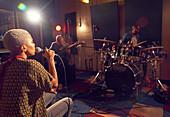 Musicians performing in recording studio