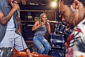 Happy musicians practicing in recording studio