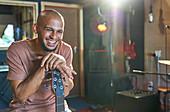 Happy male musician in recording studio