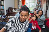Portrait playful boy celebrating Christmas