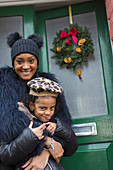 Mother and daughter with Christmas wreath