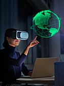 Businesswoman with VR glasses touching globe