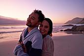 Portrait couple hugging on beach