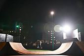 Young man skateboarding on ramp