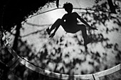 Shadow of boy jumping on trampoline