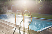 Sunny summer swimming pool