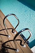 Railing at summer swimming pool