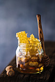 Honeycomb and nuts in jar