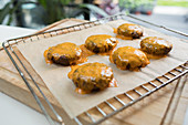 Close up cheeseburgers on cooling rack
