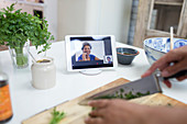 Woman cooking and video chatting