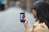 Women friends video chatting