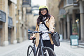 Portrait woman in helmet with bicycle