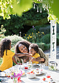 Mother and daughters eating