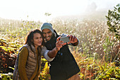 Couple taking selfie in tall grass