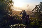 Curious couple hiking with binoculars