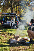 Couple camping out of car
