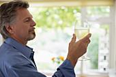 Senior man drinking white wine