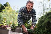 Portrait happy senior man gardening
