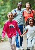 Happy family walking on path