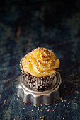 Cupcake topped with French buttercream