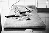 Preparing challans duck breast in a restaurant kitchen
