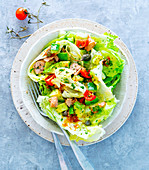 Avocado and tuna salad with cherry tomatoes