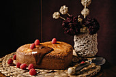 Appetizing homemade cake with fresh berries being poured with chocolate topping