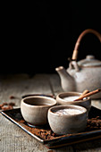 Masala chai served in ceramic bowls with star anise and cinnamon sticks