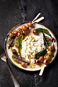 Grilled grapes with burrata, fennel seeds, olive oil and beet leaves